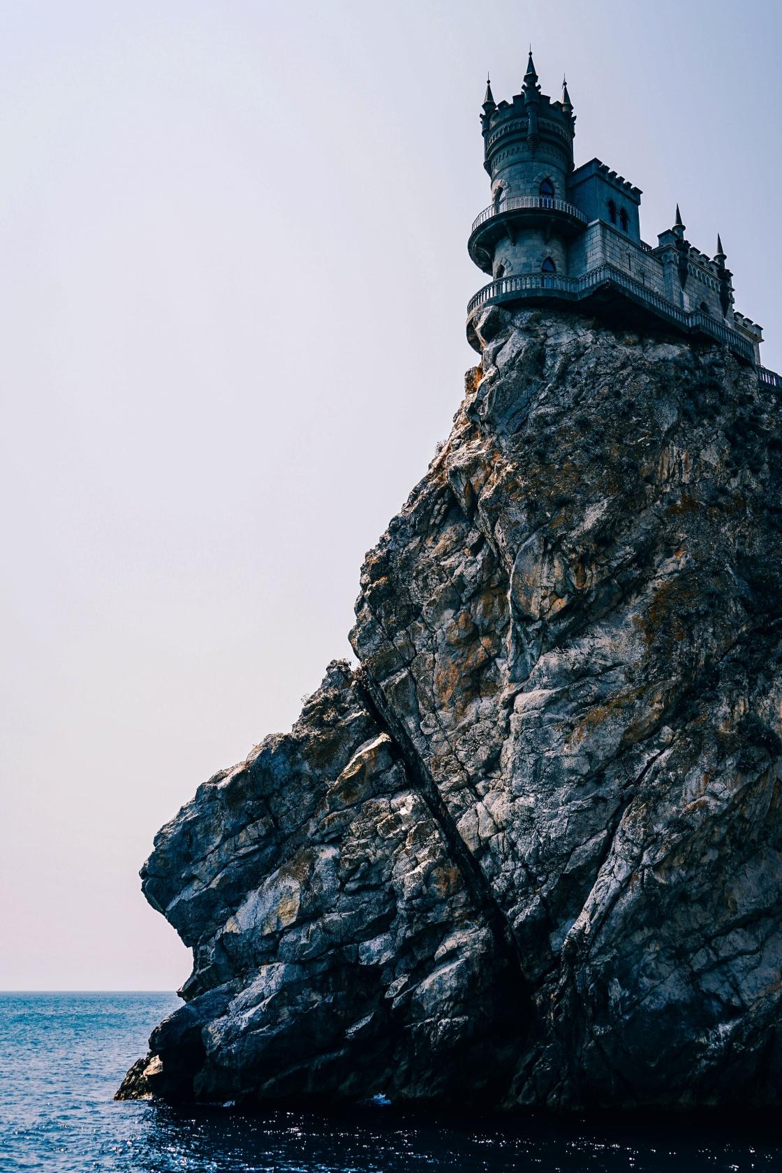 rock, formation, building, architecture, sky, sea, ocean, water, coast, hill, castle
